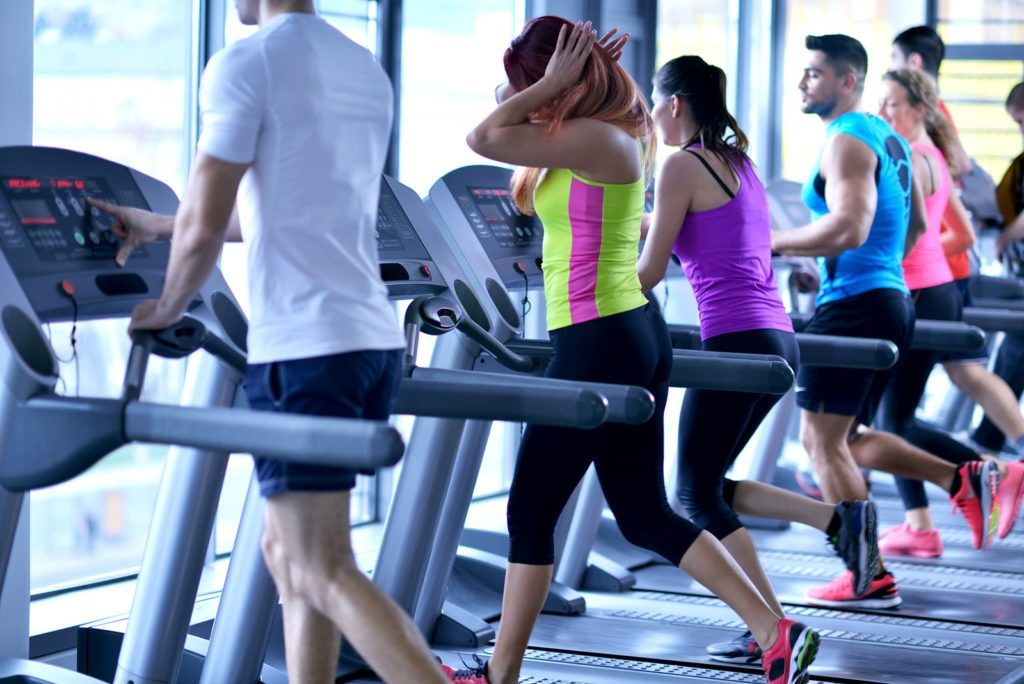 Group of people on treadmills in a gym